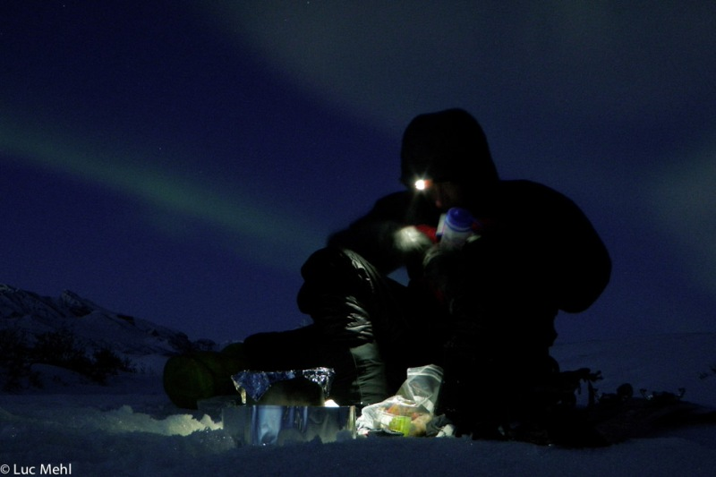 John Pekar taking a dinner break, Itkillik River, Brooks Range, Alaska. Photo by Luc Mehl, 2010